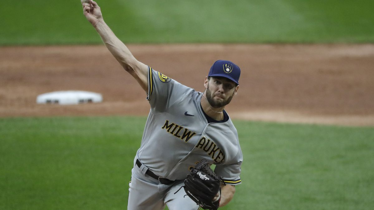 Milwaukee Brewers starting pitcher Adrian Houser throws the ball against the Chicago White Sox during the first inning of a baseball game in Chicago, Wednesday, Aug. 5, 2020. (AP Photo/Nam Y. Huh)