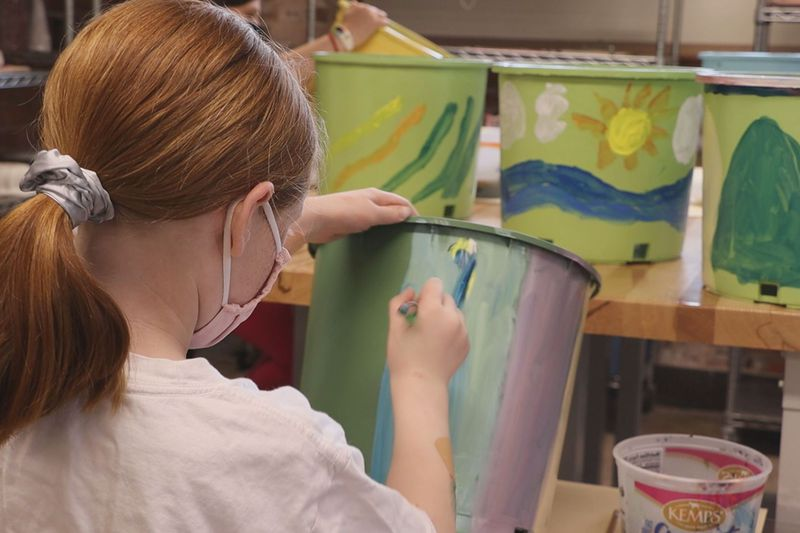 Throughout the month youth volunteers with the Center for Visual Arts in Wausau are painting...