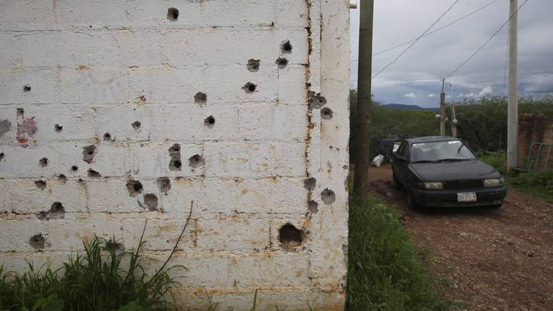 Bullet holes scar a home's exterior wall, on the outskirts of the municipality of Valparaiso,...