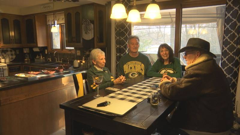 The Ewing brothers gave their Green Bay Packers playoff tickets to an 85-year-old woman.