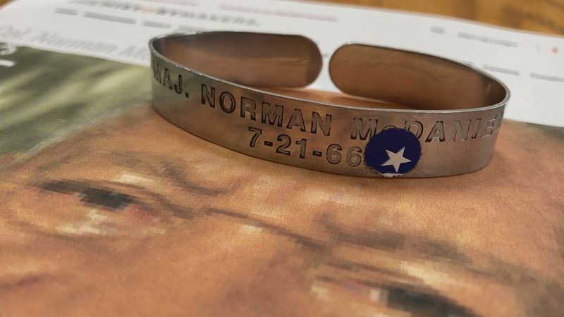 Col. Norman McDaniel was one of more than 700 American POW's with their names on bracelets...