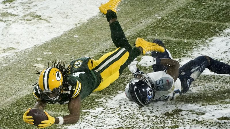 Green Bay Packers' Davante Adams gets past Tennessee Titans' Adoree' Jackson for a touchdown...