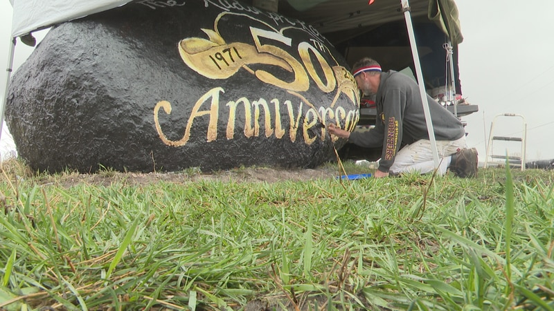 Gil Kvatek paints the rock to commemorate its 50-year anniversary.