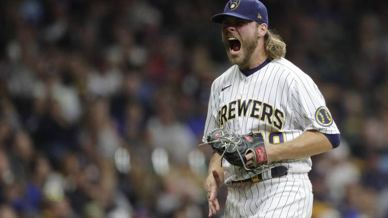Milwaukee Brewers' Corbin Burnes reacts after striking out a batter during the seventh inning...