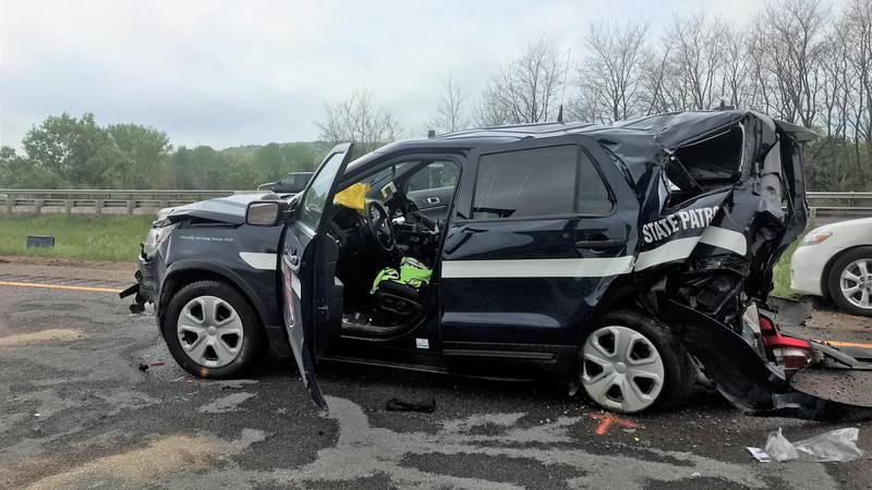 The initial investigation shows a trooper was inside her squad car during a traffic stop when...