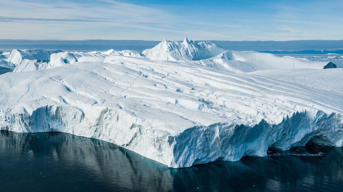 Global Warming and Climate Change - Giant Iceberg from melting glacier in Ilulissat, Greenland....