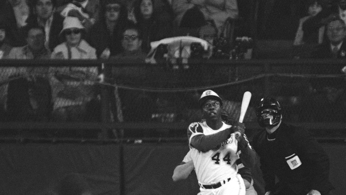n this April 8, 1974 file photo, Atlanta Braves' Hank Aaron eyes the flight of the ball after...