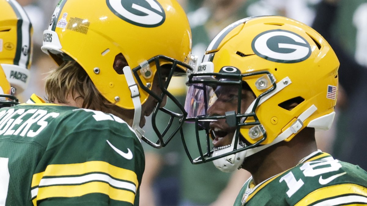 Green Bay Packers' Randall Cobb celebrates his touchdown catch with Aaron Rodgers during the...