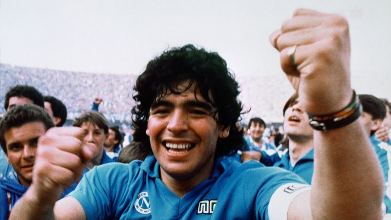 Argentine soccer superstar Diego Armando Maradona cheers after the Napoli team clinched its...