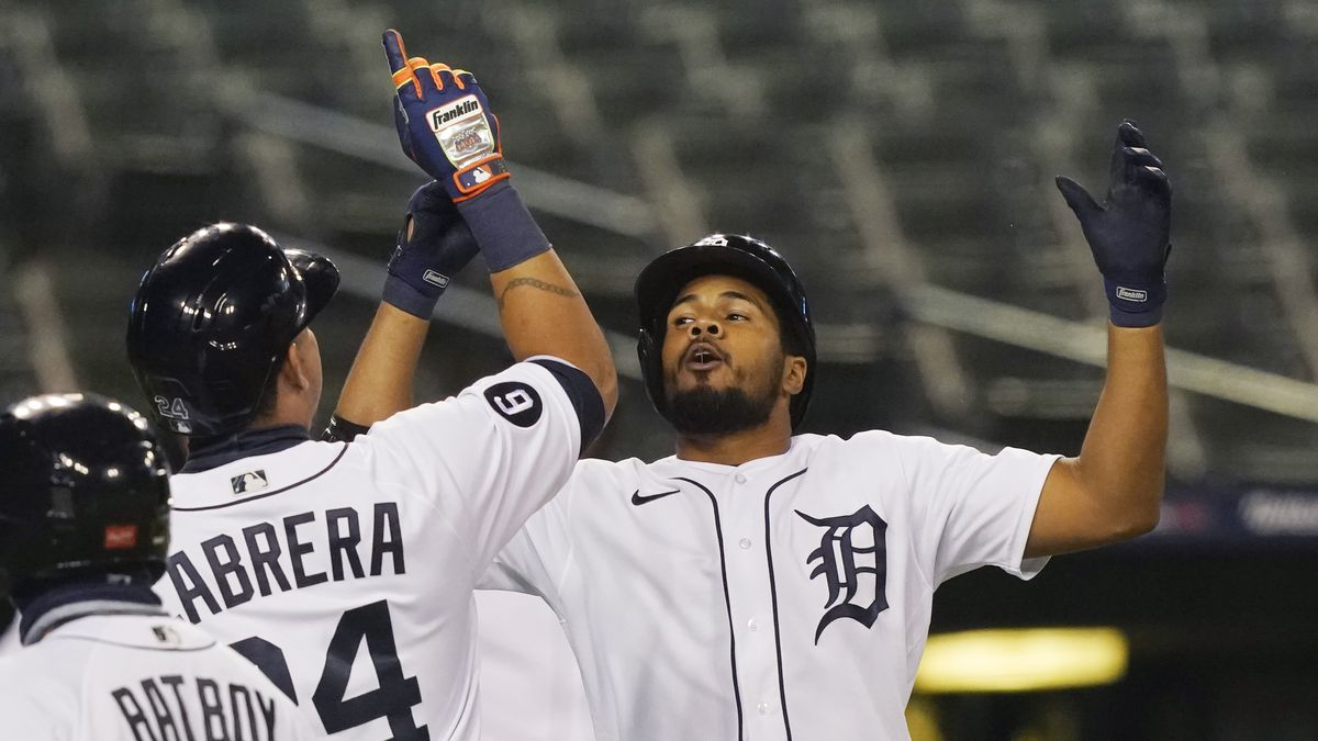 Detroit Tigers' Jeimer Candelario, right, celebrates with Miguel Cabrera after they scored on Candelario's two-run home run during the seventh inning of the team's baseball game against the Milwaukee Brewers, Tuesday, Sept. 8, 2020, in Detroit. (AP Photo/Carlos Osorio)