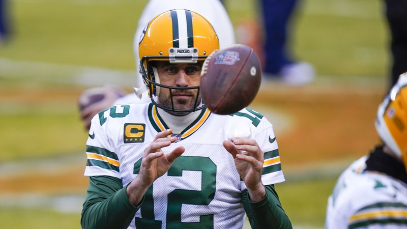 Green Bay Packers' Aaron Rodgers warms up before an NFL football game against the Chicago Bears...