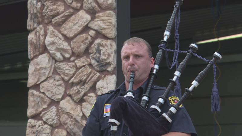 Travis Niewolny plays the bagpipes in front of the Edgar Volunteer Fire Department in Edgar, Wis.