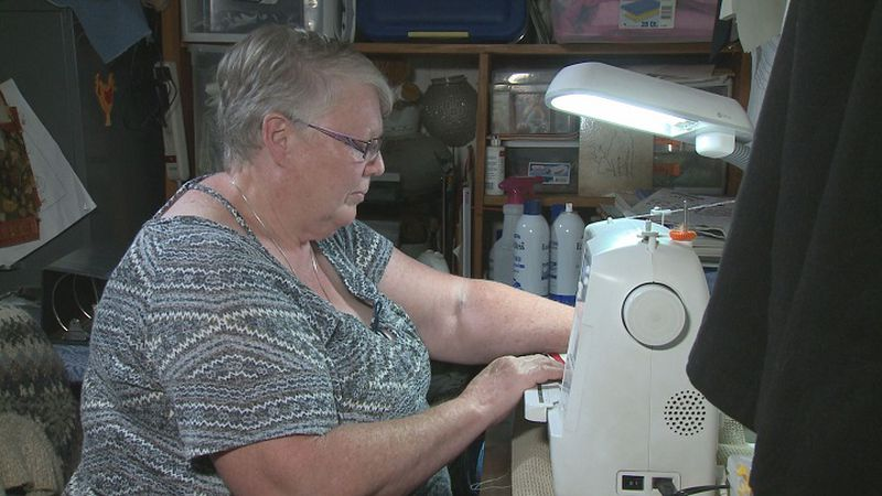 Cheryl Coyer works at her sewing machine