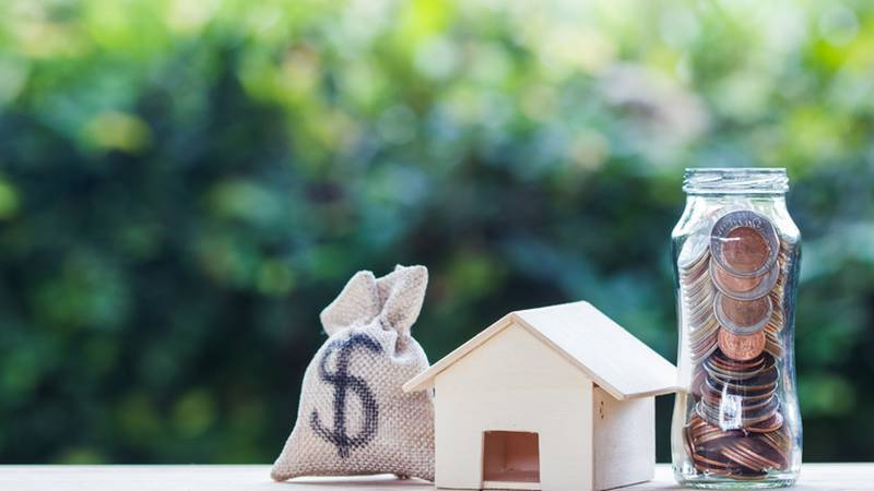 Home loan, mortgages, debt, savings money for home buying concept : US dollar in a money bag,...