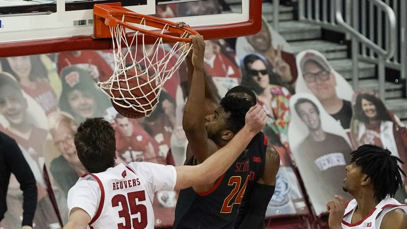 Maryland's Donta Scott dunks during the second half of an NCAA college basketball game against...