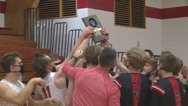 The Medford Raiders boys basketball team after winning a regional title.