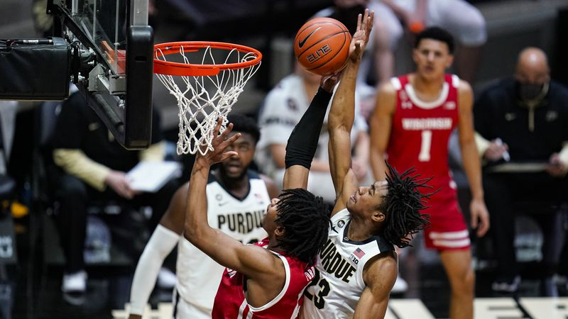 Purdue guard Jaden Ivey (23) comes from behind to block the shot of Wisconsin forward Aleem...