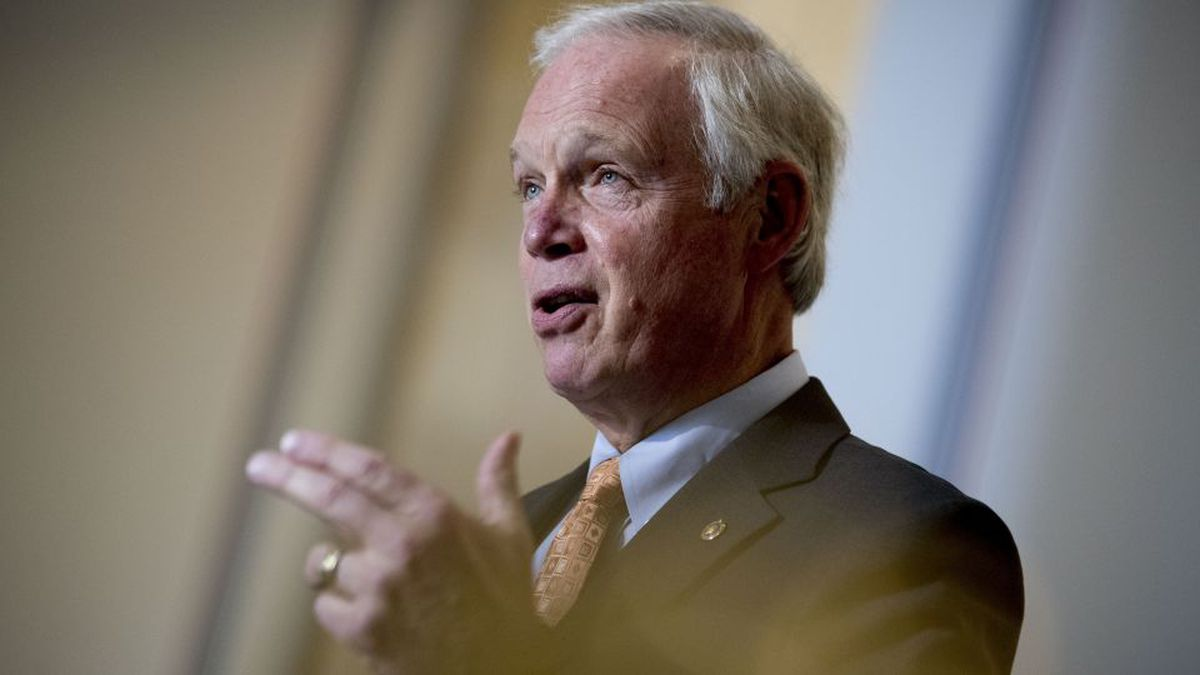 Chairman Sen. Ron Johnson, R-Wis., speaks to a reporter before the Senate Homeland Security and Governmental Affairs committee meets on Capitol Hill in Washington, Wednesday, May 20, 2020, to issue a subpoena to Blue Star Strategies. (AP Photo/Andrew Harnik)