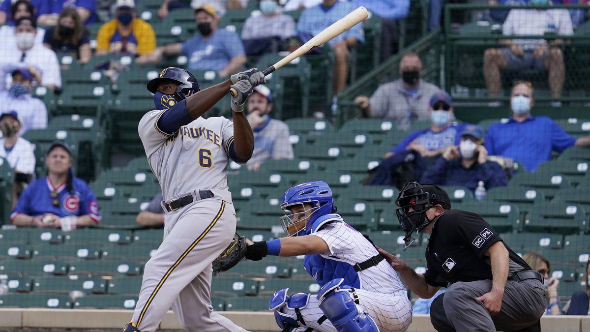 Milwaukee Brewers' Lorenzo Cain hits a three-run home run against the Chicago Cubs during the...