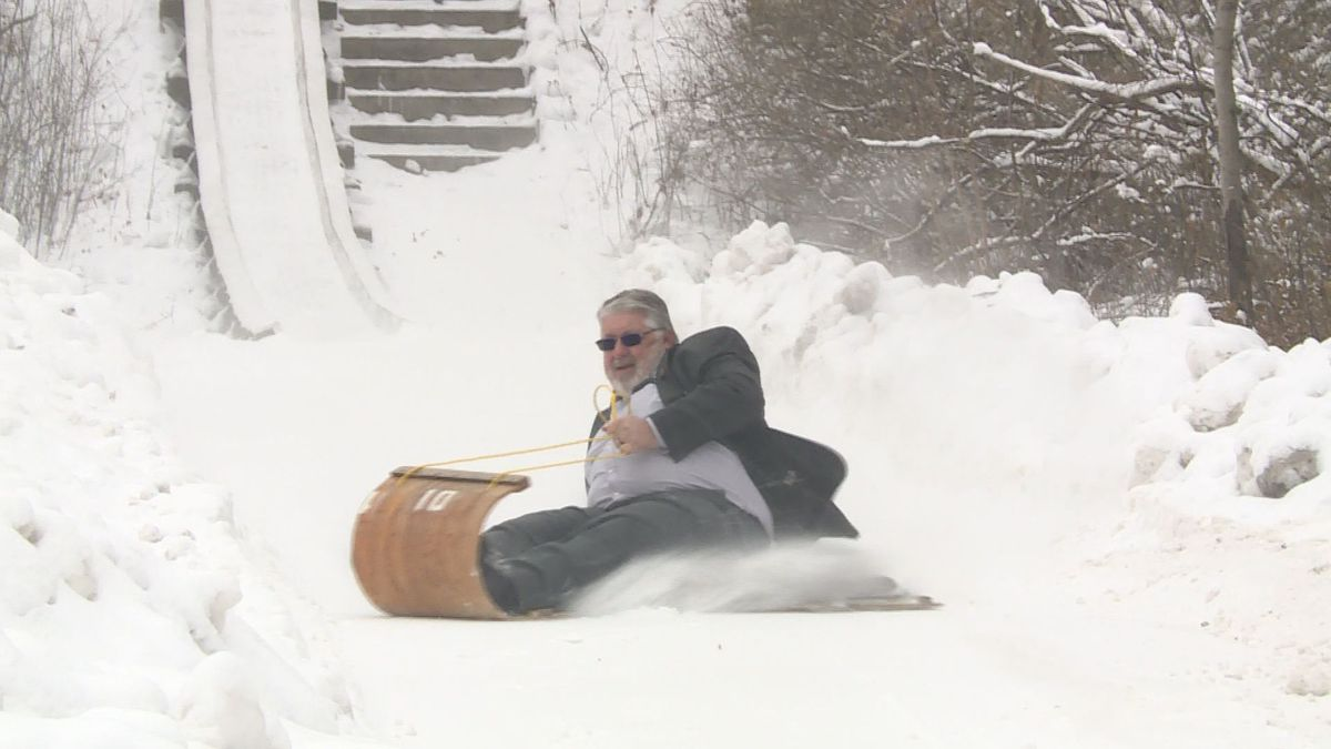 Mayor Mike Wiza of Stevens Point tests out the toboggan runs at Iverson Park on Dec. 12, 2019. (WSAW Photo)