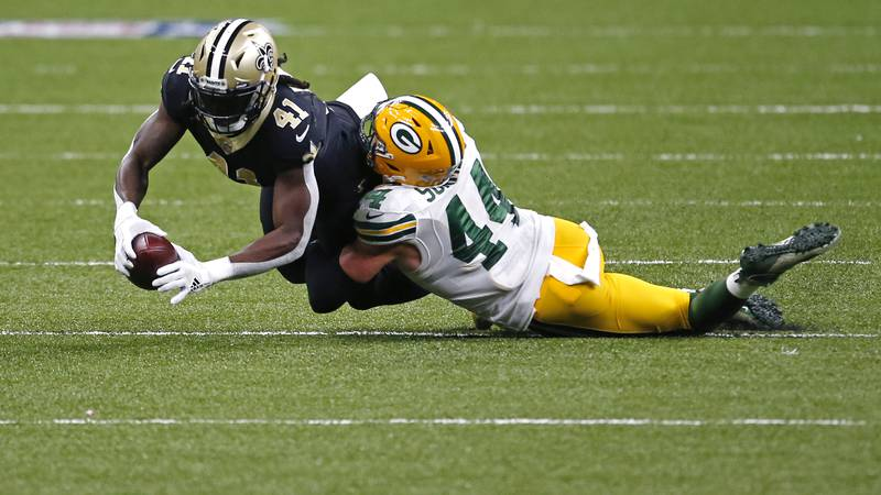 New Orleans Saints running back Alvin Kamara (41) is tackled by Green Bay Packers linebacker Ty...