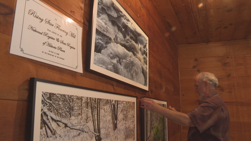 Robert Rosen hangs his photography on the walls of the Rising Star Mill in Nelsonville in...