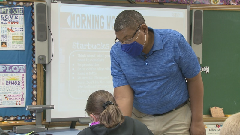 Stanley Walker, a fifth-grade teacher at Amherst Middle School gives a lesson in May, 2021 to...