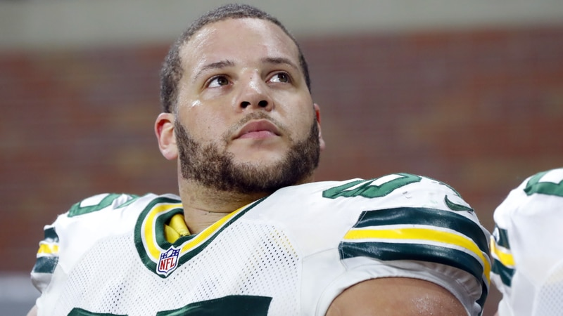 Green Bay Packers guard Lane Taylor sits on the bench during the first half of an NFL football...