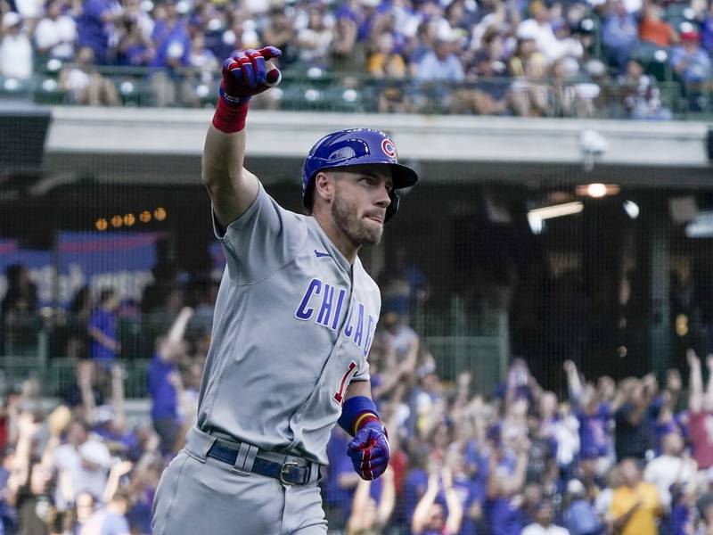 Chicago Cubs' Patrick Wisdom celebrates after hitting a three-run home run during the eighth...