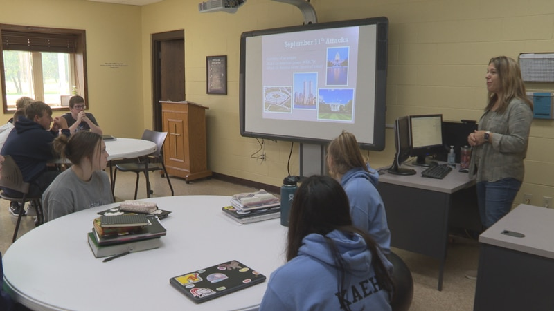 Debbie Price teaches juniors at Northland Lutheran High School about the 9/11 attacks ahead of...
