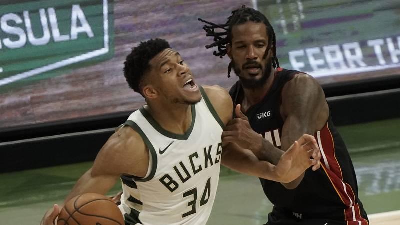 Milwaukee Bucks' Giannis Antetokounmpo drives past Miami Heat's Trevor Ariza during the first...