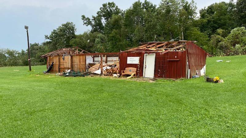 A building is damaged after an EF1 tornado touched down on August 11, 2021 in rural Monroe...