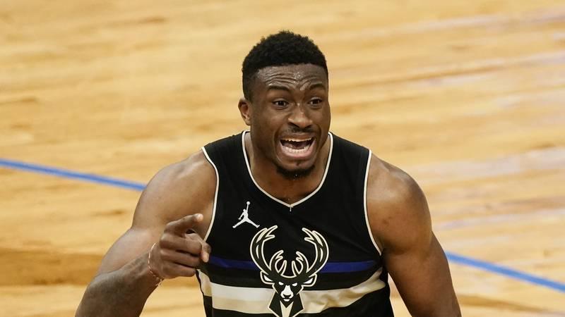 Milwaukee Bucks' Thanasis Antetokounmpo reacts to a call during the second half of an NBA...